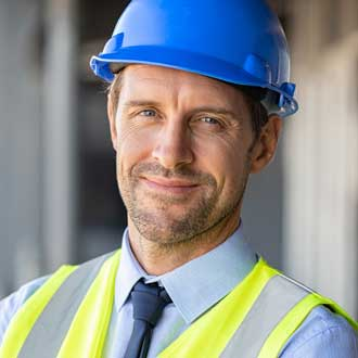 Satisfied male construction project manager who uses construction accounting software