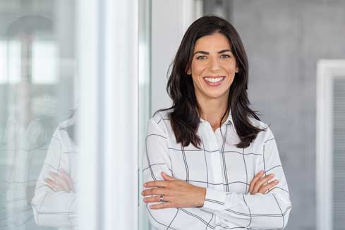 CFO of a construction company smiling because her construction invoicing is complete